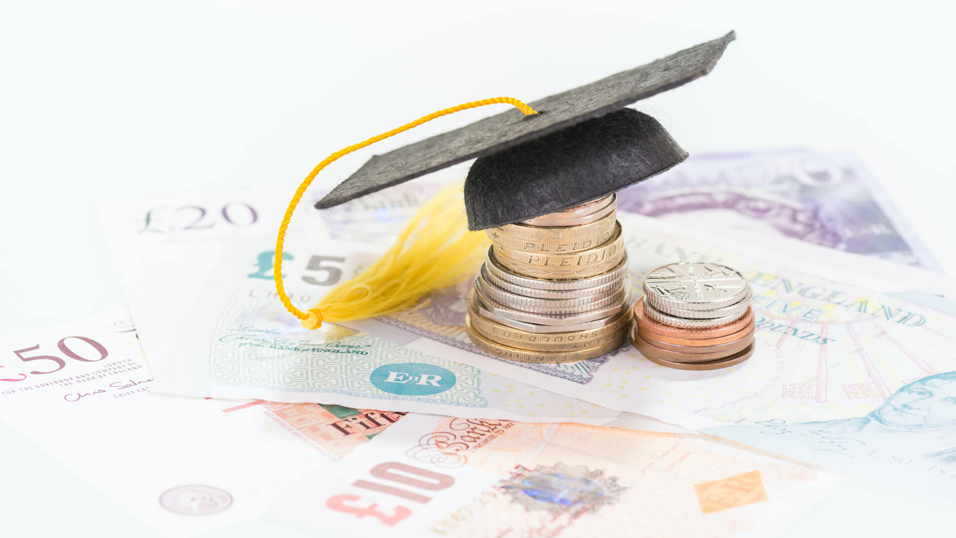 Mortar board on british pounds